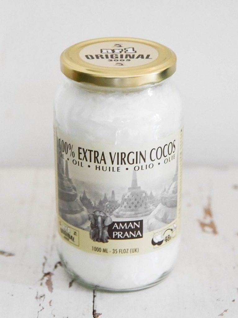De milieu vriendelijke verpakking van de kokosolie van Amanprana is van glas.