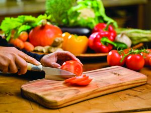 Qi-board cutting board with vegetables
